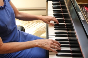 Photo of hands in playing position at a piano