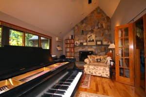 Photo of grand piano in a sunny room