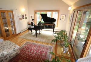 Photo of sunny room with a grand piano